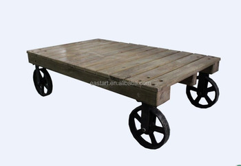 Reclaimed wooden coffee table with wheels