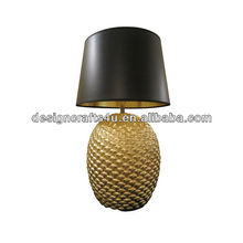 honeycomb-like chocolate & golden colored ceramic table lamp