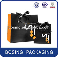 Apparel paper shopping bags with ribbon handle
