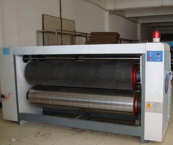 Rotary corrugated paperboard die cutting machine driven by chain