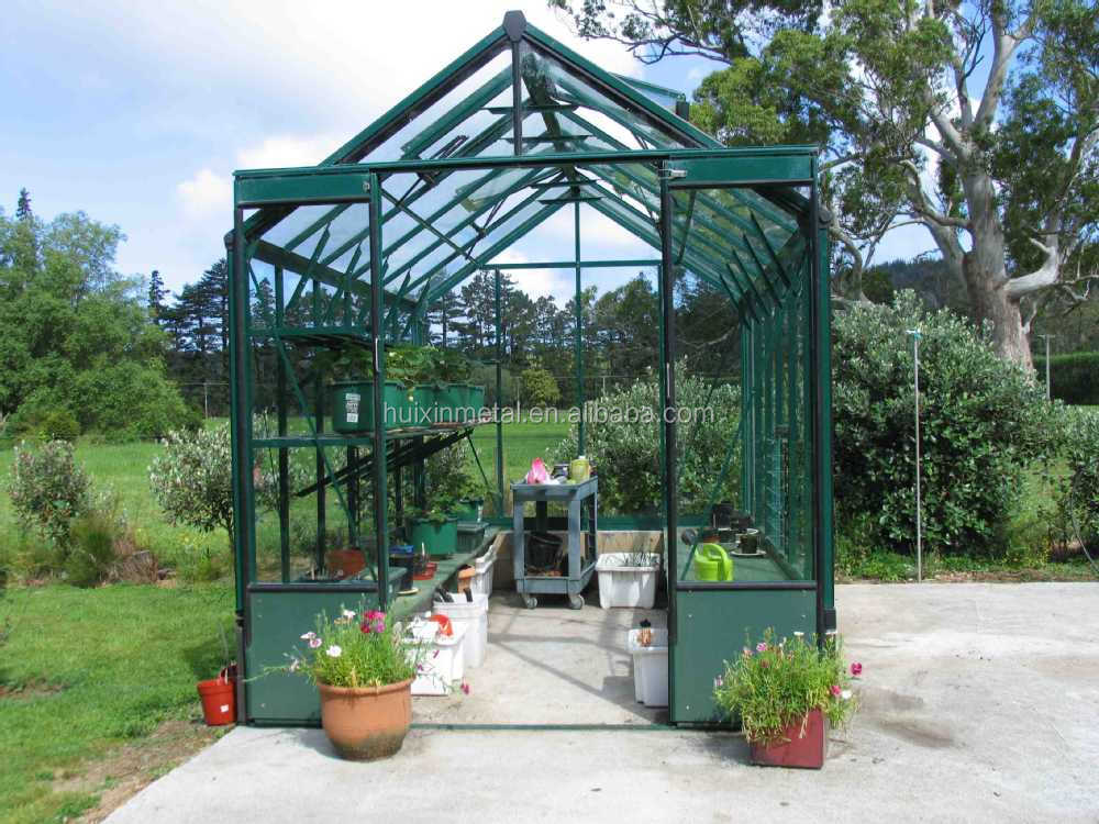 Dark green color prefabricated glass house for garden for Prefab glass house prices