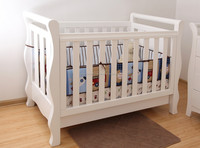 Baby sleigh cot bed with drawer