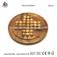 wooden round solitaire game with wooden marbles