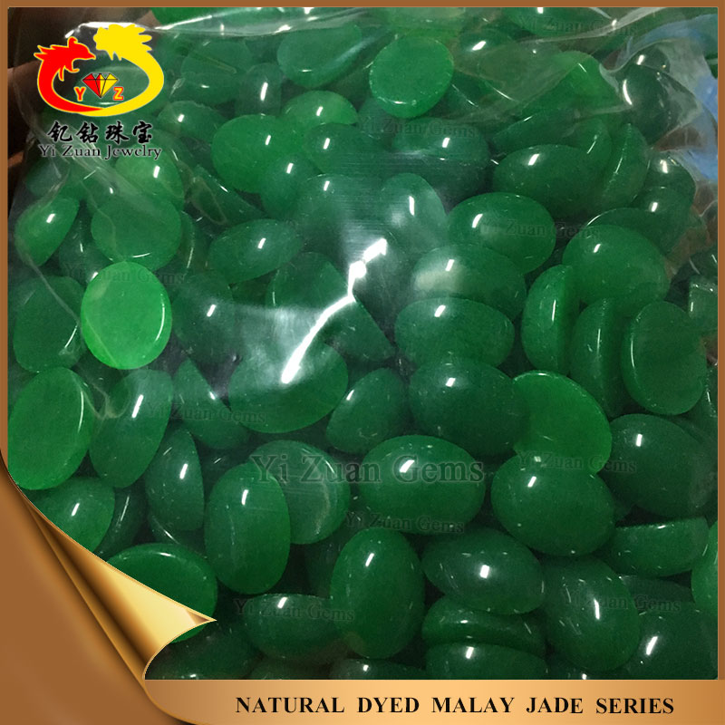 Oval shaped flat bottom cabochon dark green nephrite jade rough stone