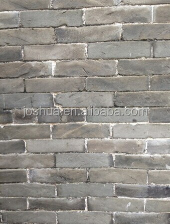 Grey old brick in 1910-1940s building brick loess material history feeling
