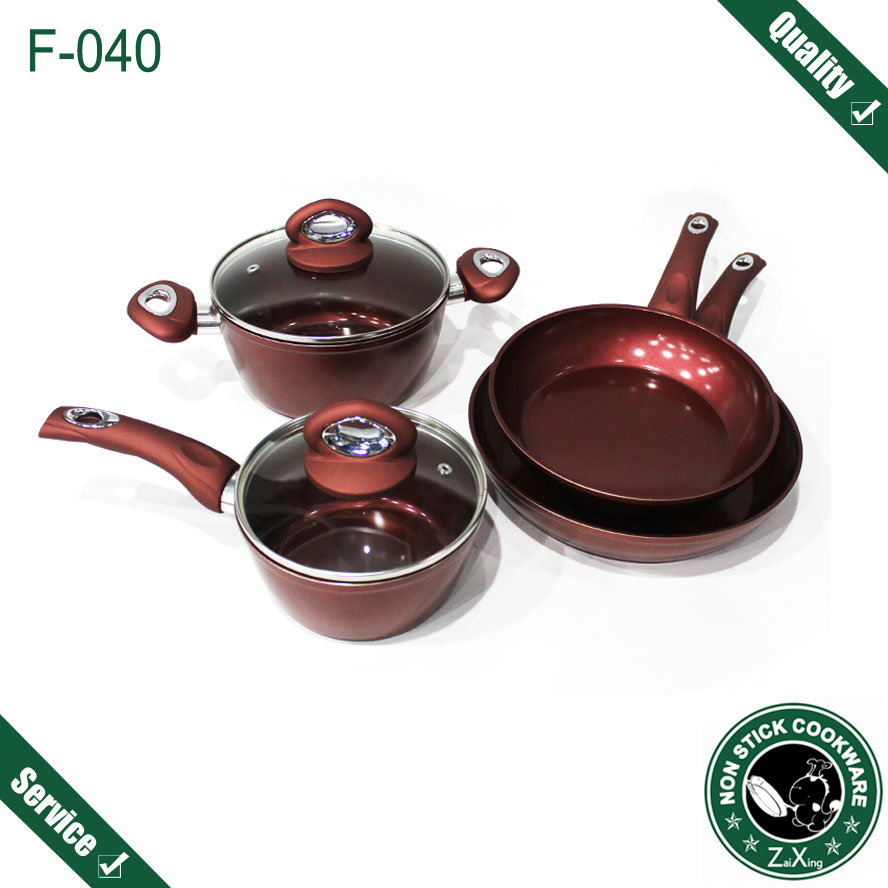 Wine red ceramic coating silicone handle forged nonstick cookware sets family cooking frying pan