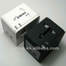 Travel adapter with universal outlet and USB