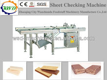 Inspection machine for wafer biscuit processing