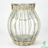 wicker covered hanging glass candle holder