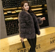 Woman's winter coat and ostrich sweater vest Beautiful winter coat/ turkey feather long coat