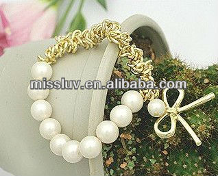 fashion gold chains and bow elastic pearl bracelets,simple strech beads bracelets,metal pendant jewelry