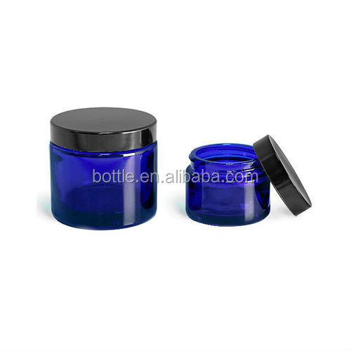 Empty cobalt blue thick glass straight sided jar - 2 oz / 60 ml