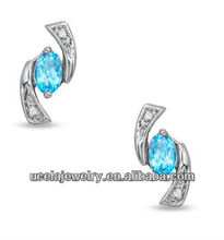 5.0mm Oval Blue Topaz and Diamond Accent Boomerang Earrings dubai 10K White Gold jewelry