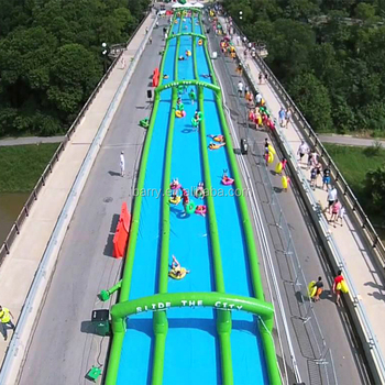 Long crazy singel/double/three lane slide the city , inflatable water slip n slide for adult