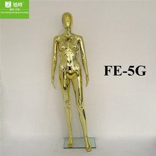 Chrome gold or silver mannequin of female model for wedding display