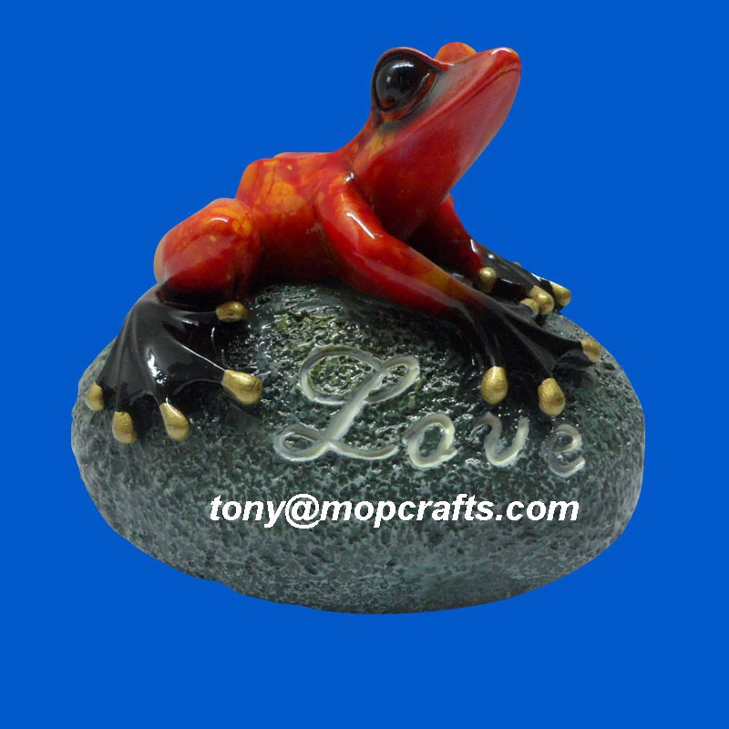 Polyresin red frog on stone