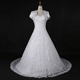 White lace A-line wedding dress with short sleeve jacket