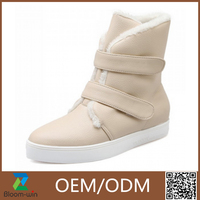 2015 fashion high quality pu leather snow sheepskin boot for women manufacturer