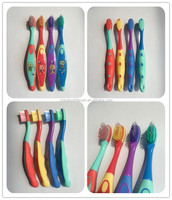 becatiful cartoon pictures on the kids toothbrush handle and with tongue cleaner
