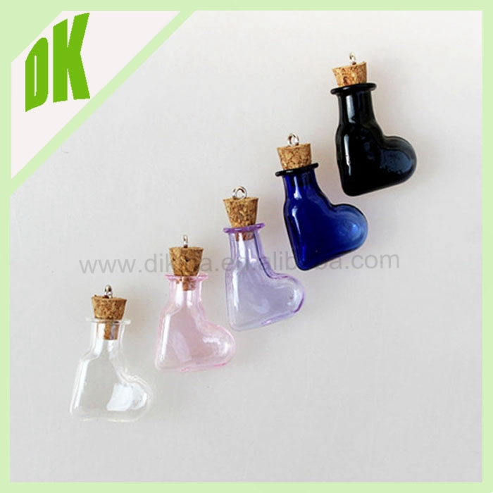 2016 Guangzhou glass bottle manufacturer mexico wholesale heart shaped borosilicate clear glass bottle