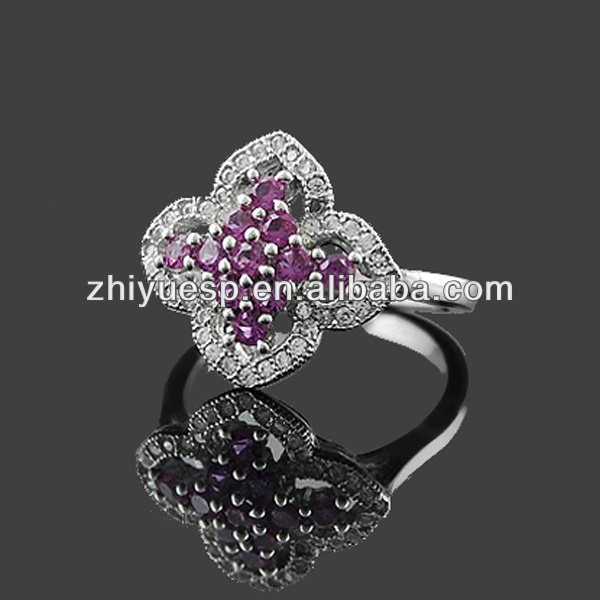 White and purple diamond four leaf clover finger ring