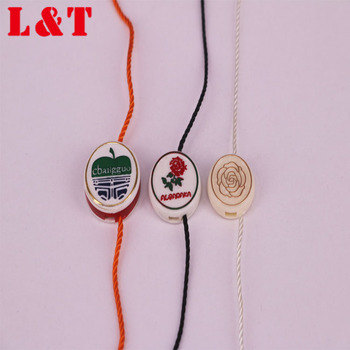 Factory Price Plastic foil seal tag Garment Accessories elastic string hang tag string fastener seal tag with custom logo