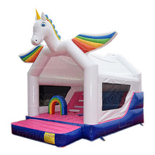 dazzling rainbow kids used commercial inflatable jumping castle, cheap large children unicorn bouncy castle with slide for sale