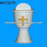 Religious white ceramic cross chalice