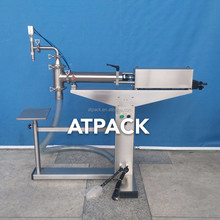 Atpack high-accuracy semi-automatic atlas copco compressor lubricate /Synthetic /mineral oil filling machine with CE GMP