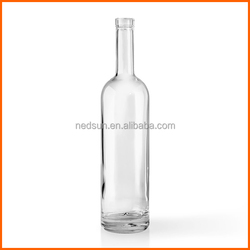 Whiskey clear round tall glass bottles with corks