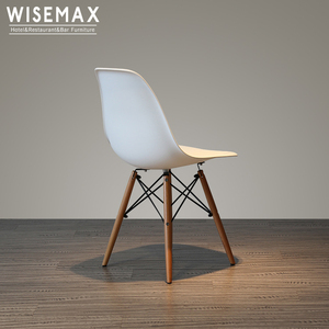 Wholesale price modern cheap designer plastic wedding chair in dining chairs with wooden legs