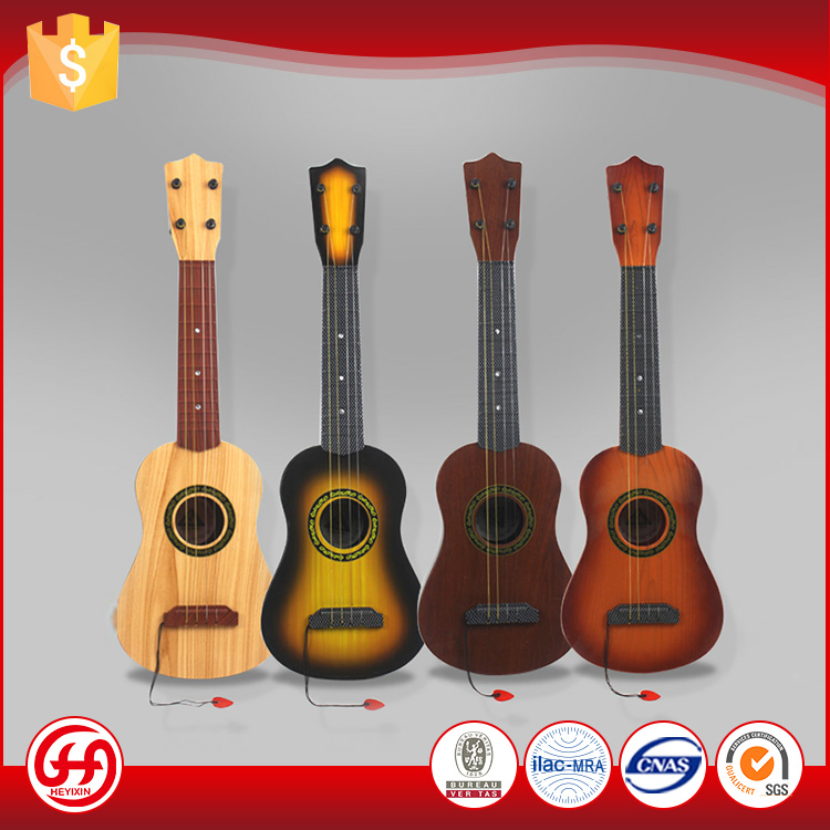 Alibaba high standard Imitation oak children musical ABS plastic guitar toy