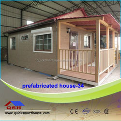 red wooden home within low cost wooden cubby house