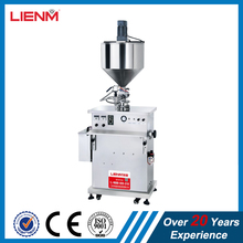 Semi automatic wax hot filling machine with heater, mixer and hopper