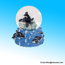 polyresin Killer Whales Swimming in the Ocean Glass Musical Snow Globe