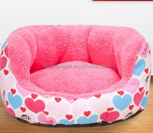 Red comfortable pet beds and sofa with cartoon heart picture