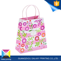 High quality printing manufacturer pink flower printed shopping customized cosmetic paper gift bag with handle