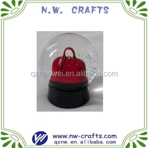 Resin handbag snow globe