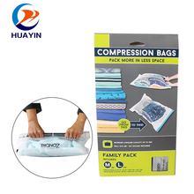 Clothes roll up vacuum traveling storage bag