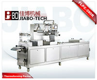 Automatic thermoforming food vacuum packaging machine