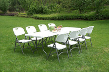white plastic outdoor table and chair
