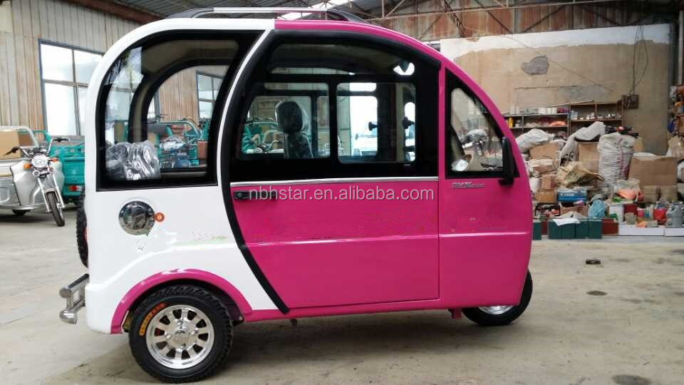 close type auto rickshaw electric tricycle with passenger seat