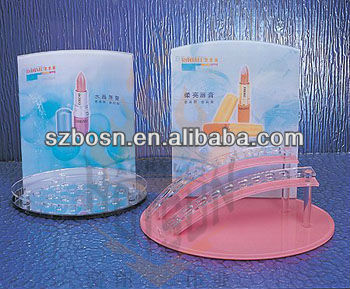 Transparent clear acrylic makeup display with poster holder