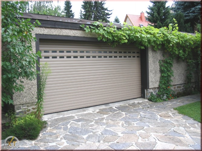 Enrollables puertas de garaje puertas identificaci n del for Puertas monoblock precio