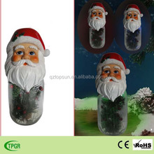 Christmas decoration polyresin santa claus with galss bottle solar light