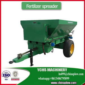 Tractor behind fertilizer spreader used for manure and fertilizer