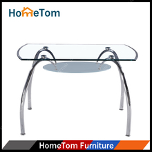 UK Popular Oval Clear Tempered Glass Top Chrome Legs Dining Table