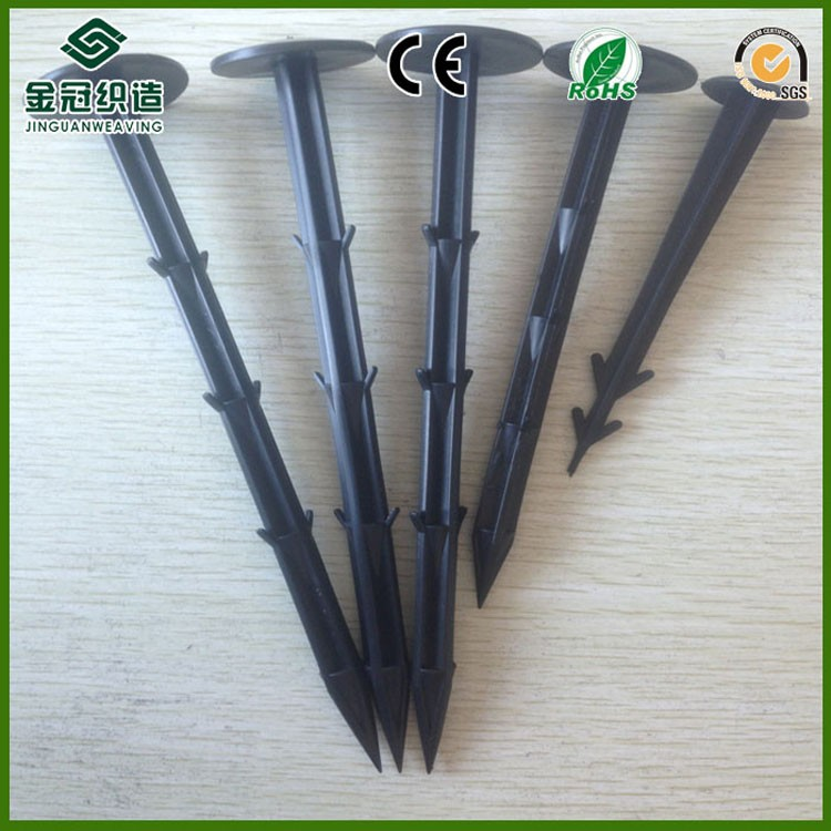 Iron mulch pegs for fixing ground cover