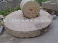 Garden old antique millstone with natural surface used for garden decoration