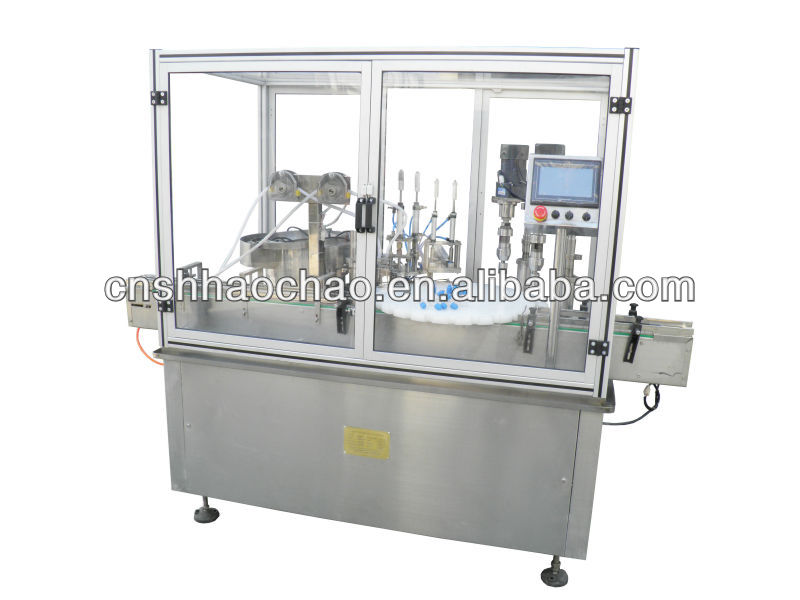 new style robot hand electronic cigarette oil filling,plugging and capping machine ,small dose liquid filling and capping machin